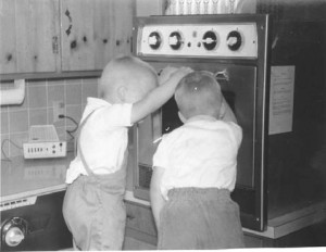 Boys looking at oven